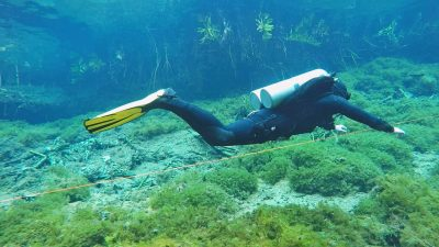 "Article - Sidemount divers going ""back"" to backmount"